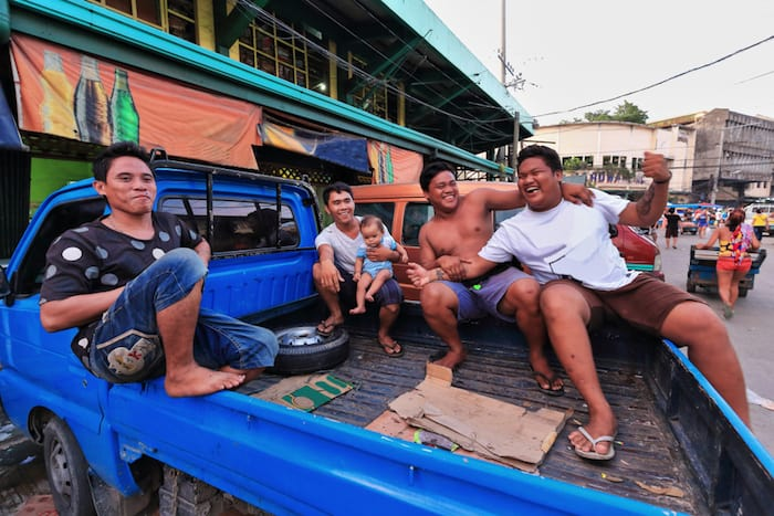 Local Filipinos at the Carbon Market - the oldest and largest farmer's market in town.